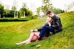 Young couple having fun and hugging in the park. Royalty Free Stock Photography