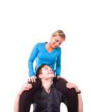 Young couple is having fun (isolated on white).  stock photo