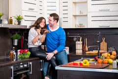 Young couple having fun in the kitchen Royalty Free Stock Image