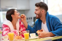 Couple having fun in kitchen during breakfast Royalty Free Stock Photography