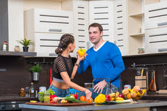 Young couple having fun in the kitchen Stock Photo