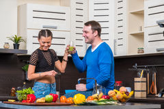 Young couple having fun in the kitchen Royalty Free Stock Photos