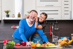 Young couple having fun in the kitchen Royalty Free Stock Images