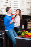 Young couple having fun in the kitchen Stock Photos