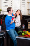 Young couple having fun in the kitchen Royalty Free Stock Photo