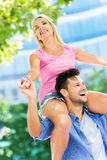 Young couple having fun outdoors Royalty Free Stock Photos