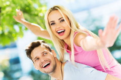 Young couple having fun outdoors Royalty Free Stock Photo