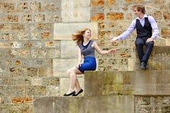 Young couple having fun at Parisian embankment Royalty Free Stock Photos