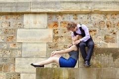 Young couple having fun at Parisian embankment Royalty Free Stock Photo
