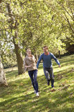 Young couple having fun in park Stock Photography