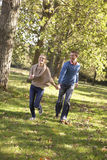 Young couple having fun in park Stock Images