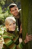 Young couple having fun in park Royalty Free Stock Images