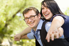 Young Couple Having Fun in the Park Royalty Free Stock Photo