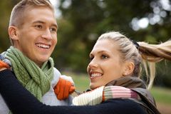 Young couple having fun in park Royalty Free Stock Photography