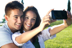 Young couple having fun in a park Royalty Free Stock Photography