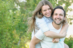 Young couple having fun in the park in summer time Royalty Free Stock Photos