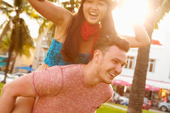 Young Couple Having Fun In Park Together Stock Photo