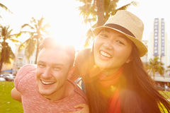 Young Couple Having Fun In Park Together Stock Images