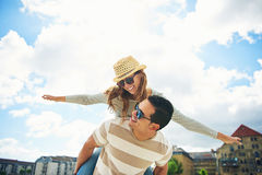 Young couple having fun piggy backing Stock Image