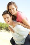 Young Couple Having Fun Piggyback Ride Royalty Free Stock Image