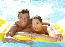 Young couple having fun in pool Stock Image