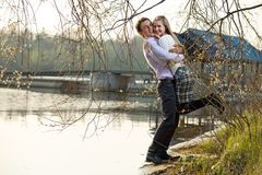 Young couple at river beach Stock Images
