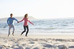 Young Couple Having Fun On Sandy Beach Royalty Free Stock Photos
