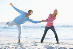 Young Couple Having Fun On Sandy Beach On Holiday Royalty Free Stock Images