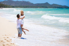 Young couple having fun on a sandy beach Stock Images