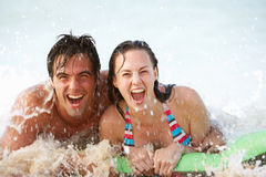 Young Couple Having Fun In Sea On Airbed Stock Photo