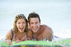 Young Couple Having Fun In Sea On Airbed royalty free stock photo