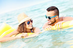 Young couple having fun in the sea Royalty Free Stock Image