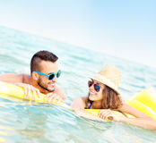 Young couple having fun in the sea Royalty Free Stock Images