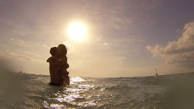 Young couple having fun in the sea stock footage