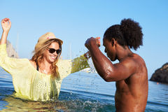 Young Couple Having Fun In Sea Together Stock Images