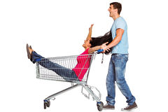 Young couple having fun with shopping cart Stock Photography
