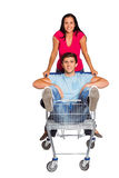 Young couple having fun with shopping cart Stock Images