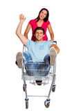 Young couple having fun with shopping cart Royalty Free Stock Photo