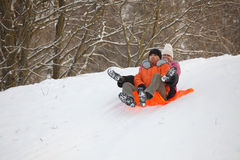 Young couple having fun in snow Stock Photos