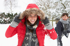 Young couple having fun in the snow Stock Photo