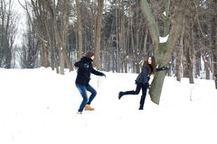 Young couple having fun in the snow Royalty Free Stock Images