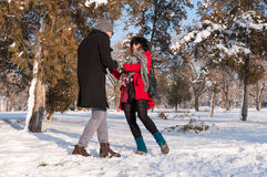 Young couple having fun on the snow Stock Photo
