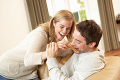 Young couple having fun on sofa Stock Image