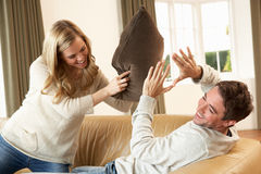 Young couple having fun on sofa Royalty Free Stock Images