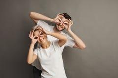 Young couple having fun, studio portrait Stock Photo