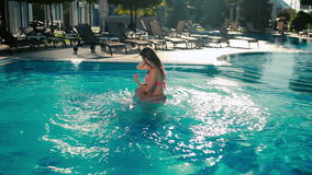 Young couple are having fun in the swimming pool stock video