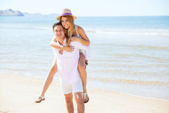 Young couple having fun together at the beach Stock Photography