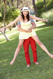 Young Couple Having Fun Together In Garden. In Summertime Stock Image