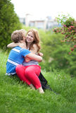 Young couple having fun together in park Royalty Free Stock Images