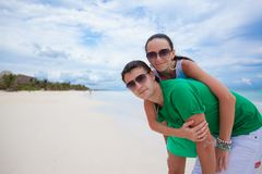 Young couple having fun on a tropical beach Royalty Free Stock Photo